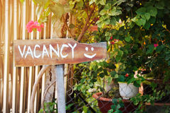 Pointer with the vacancy. Outdoor pointer with the vacancy word and smile stock images