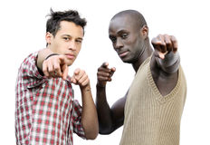 Pointing. Two young men, one black and one Caucasian, pointing at the camera Royalty Free Stock Image