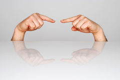 Pointing. Two fingers at each other stock photography