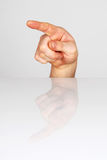 Pointing. Finger pointing in one direction Stock Photography