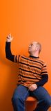 Pointing. Man pointing something over his head - copyspace stock photography