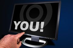 Pointing. Monitor with finger stock photography