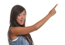 Pointing asian woman on a white background Royalty Free Stock Photos
