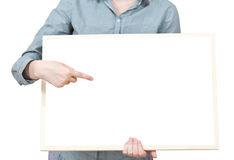 Pointing on blank bulletin board in female hand Stock Image
