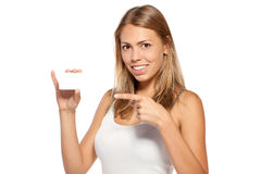Pointing at blank card Stock Photography