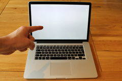 Pointing at blank Laptop with left hand Stock Image