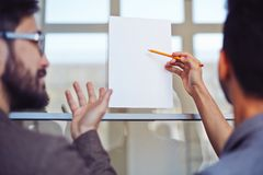 Pointing at blank paper Royalty Free Stock Photography
