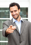 Pointing businessman in front of his office Stock Photo