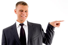 Pointing businessman looking at camera Royalty Free Stock Photography