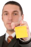 Pointing businessman with sticker Royalty Free Stock Photos