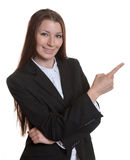 Pointing businesswoman with brunette hair Stock Photo