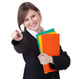 Pointing businesswoman with folders Stock Photo
