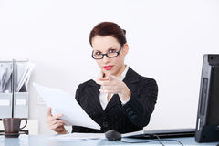 Pointing businesswoman holding files. Royalty Free Stock Photos