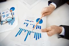 Pointing at chart and graph Stock Photos