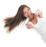 Pointing cheerful woman royalty free stock images