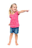 Pointing child. Isolated young blonde girl points out of frame, good area for copyspace stock images