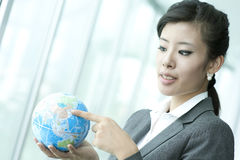 Pointing at China on Earth Globe Stock Images