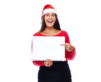 Pointing Christmas Santa girl Laptop. Woman In Christmas outfit Showing White Laptop Royalty Free Stock Photography