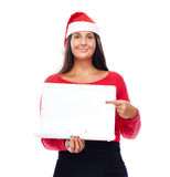 Pointing Christmas Santa girl Laptop. Woman In Christmas outfit Showing White Laptop Stock Image