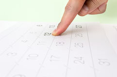 Pointing the citation on the calendar Stock Image