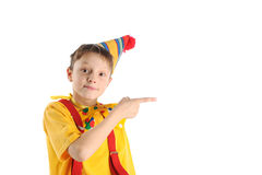 Pointing clown boy. Cheerful funny dressed boy pointing by his finger Royalty Free Stock Photos