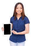 Pointing copy space on her tablet. Royalty Free Stock Photos