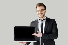 Pointing copy space on his laptop. Stock Images