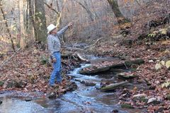 Pointing Cowboy Stock Photo