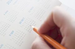 Pointing the date of calendar Stock Image