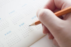 Pointing the date of calendar Royalty Free Stock Photos