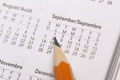 Pointing date on calendar Royalty Free Stock Photos