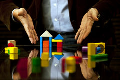 Pointing design, advice, Real Estate, Expertise an. Colorful wooden toy blocks used to Pointing issues about design, advice, real Estate, expertise, strategy stock image