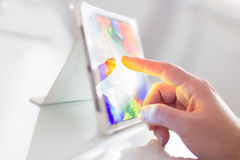Pointing on digital tablet Stock Photography