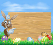 Pointing Easter bunny wooden sign Royalty Free Stock Photos