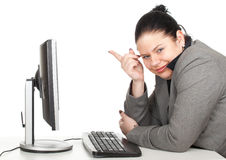Pointing fat businesswoman and computer Royalty Free Stock Photo