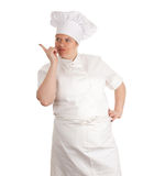 Pointing fat female cook, series Royalty Free Stock Photography
