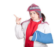 Pointing fat girl with broken hand Royalty Free Stock Image