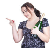 Pointing fat girl with champagne Stock Photo
