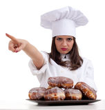 Pointing female chef with donuts Royalty Free Stock Photography
