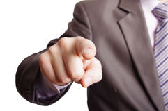 Pointing a finger. A suited man poiting a finger at you on white background Stock Photos