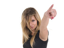 Pointing Finger. A portrait of a beautiful young woman with pointing finger, isolated on a white background Stock Photography