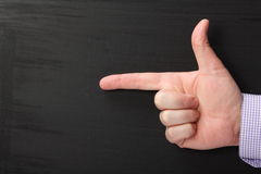 Pointing Finger and Blackboard Stock Photography