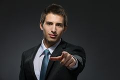 Pointing with finger manager Stock Images