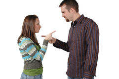 Pointing Fingers. Man and woman point fingers at each other over a disagreement Royalty Free Stock Photo