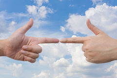 Pointing fingers at each other Stock Images