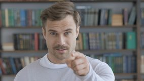 Pointing with Fingure Gesture by Beard Adult Man. High quality stock images
