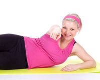 Pointing fitness woman Royalty Free Stock Image