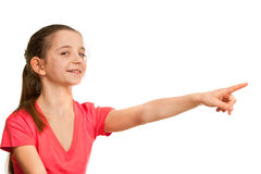 Pointing forward girl in red Stock Images