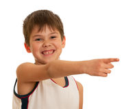 Pointing forward happy kid Royalty Free Stock Photos