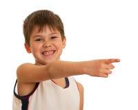 Pointing forward happy kid Royalty Free Stock Photos